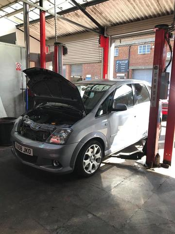 An image of a car on a ramp in the Griffin Autos garage, having an MOT test carried out.