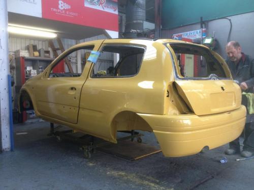 Yellow car in bodyshop